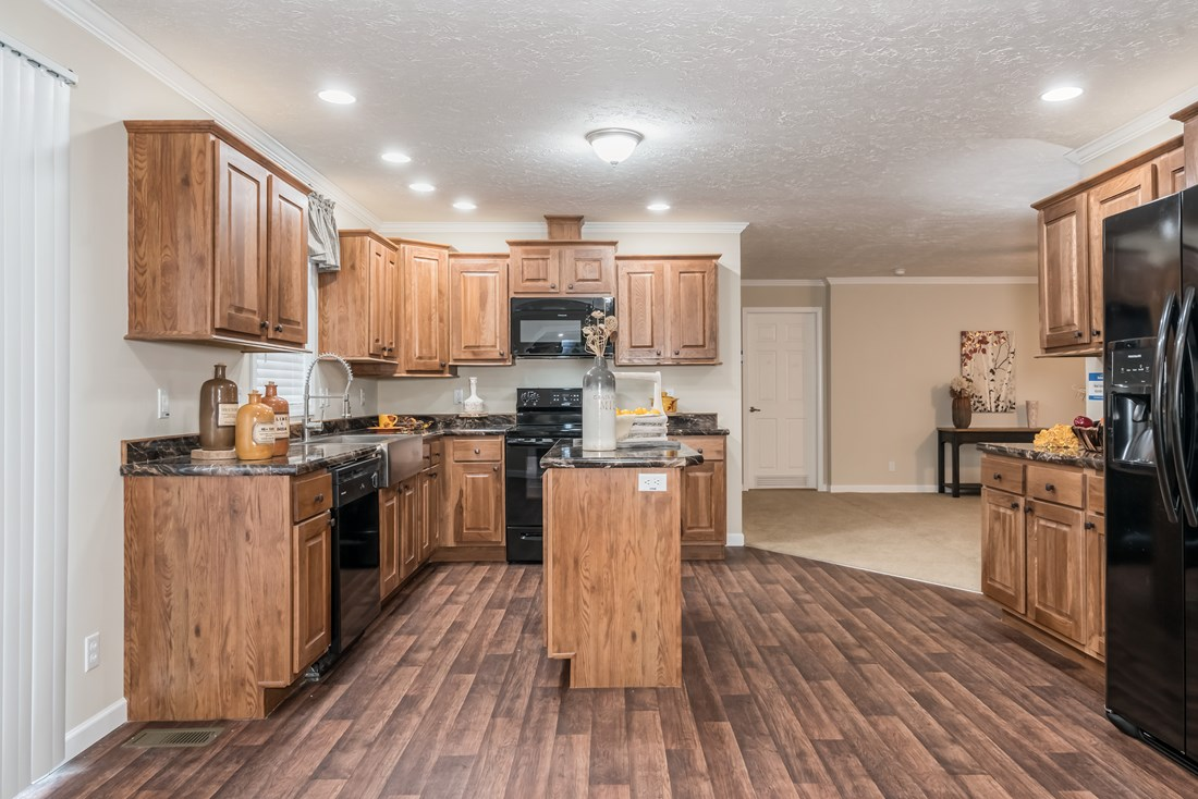 The BROOKLINE FLEX Kitchen. This Manufactured Mobile Home features 4 bedrooms and 2 baths.