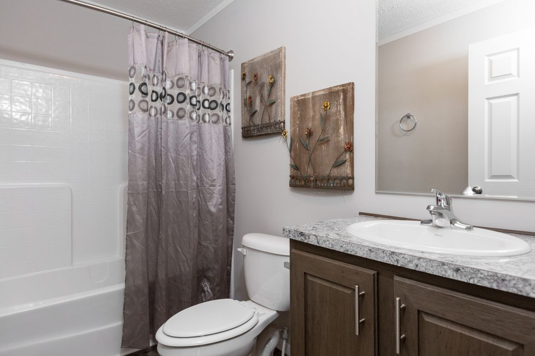The DURANGO Guest Bathroom. This Manufactured Mobile Home features 3 bedrooms and 2 baths.