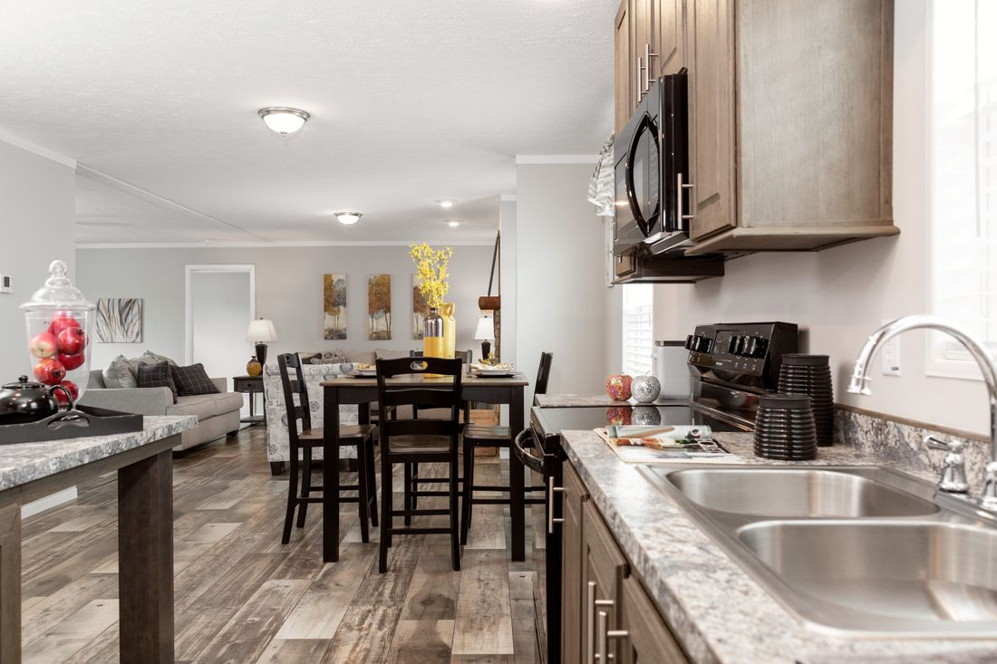 The DURANGO Dining Area. This Manufactured Mobile Home features 3 bedrooms and 2 baths.