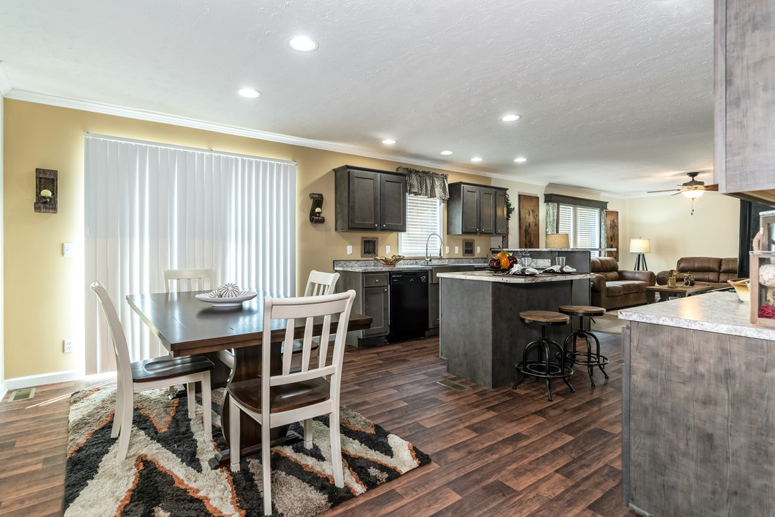 The WINCHESTER FLEX Dining Area. This Manufactured Mobile Home features 4 bedrooms and 2 baths.