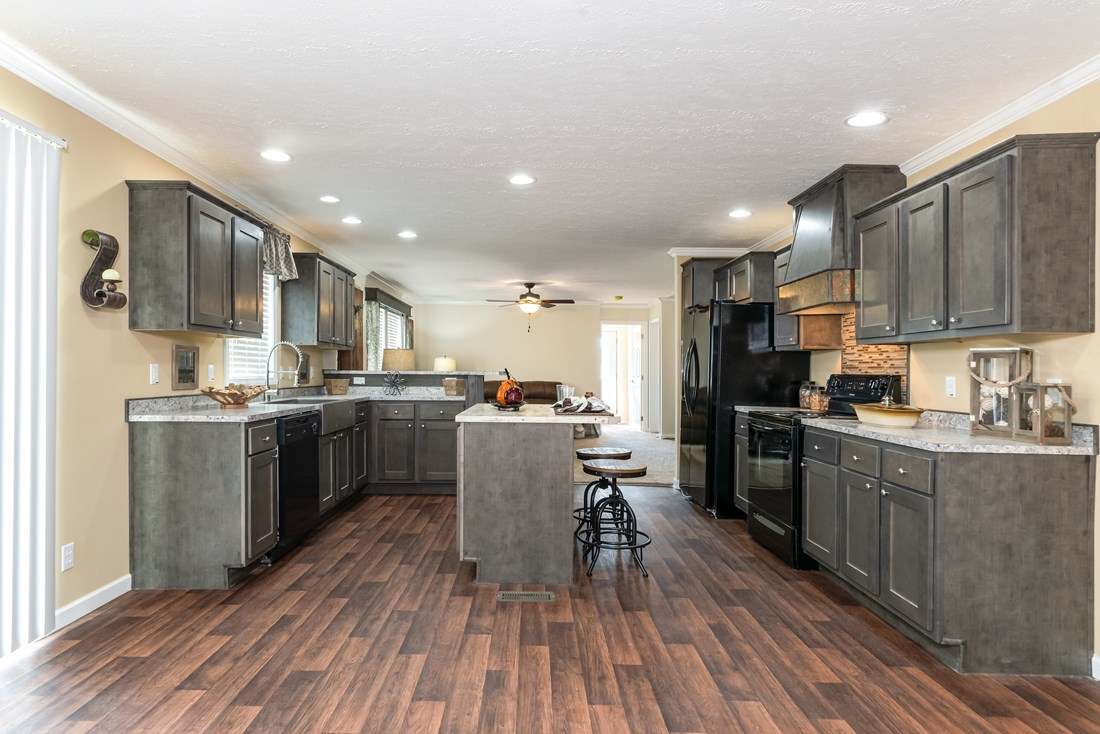 The WINCHESTER FLEX Kitchen. This Manufactured Mobile Home features 4 bedrooms and 2 baths.