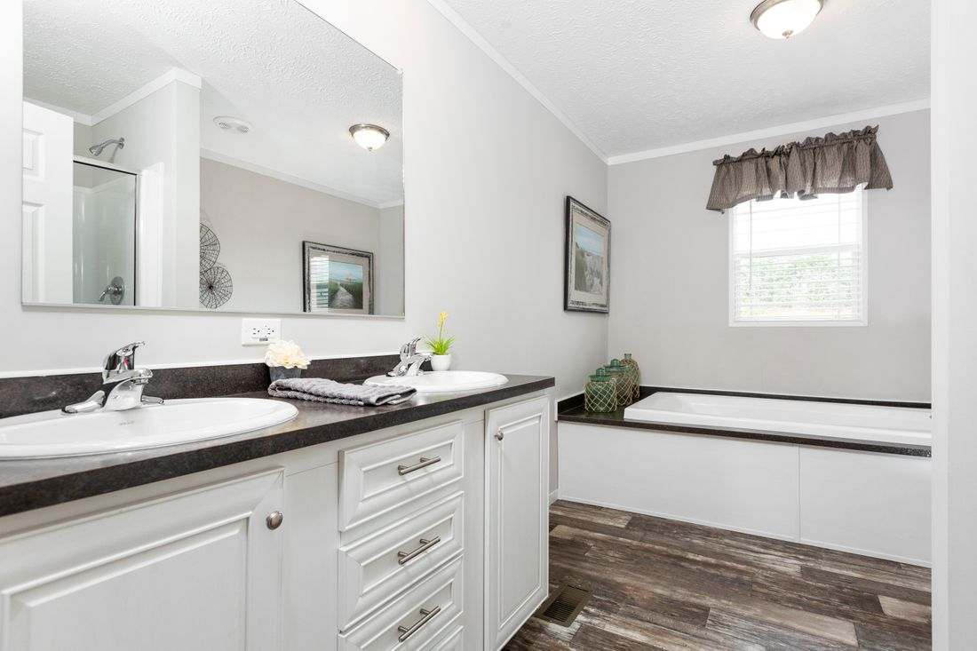 The SANTA FE 684A Master Bathroom. This Manufactured Mobile Home features 4 bedrooms and 2 baths.