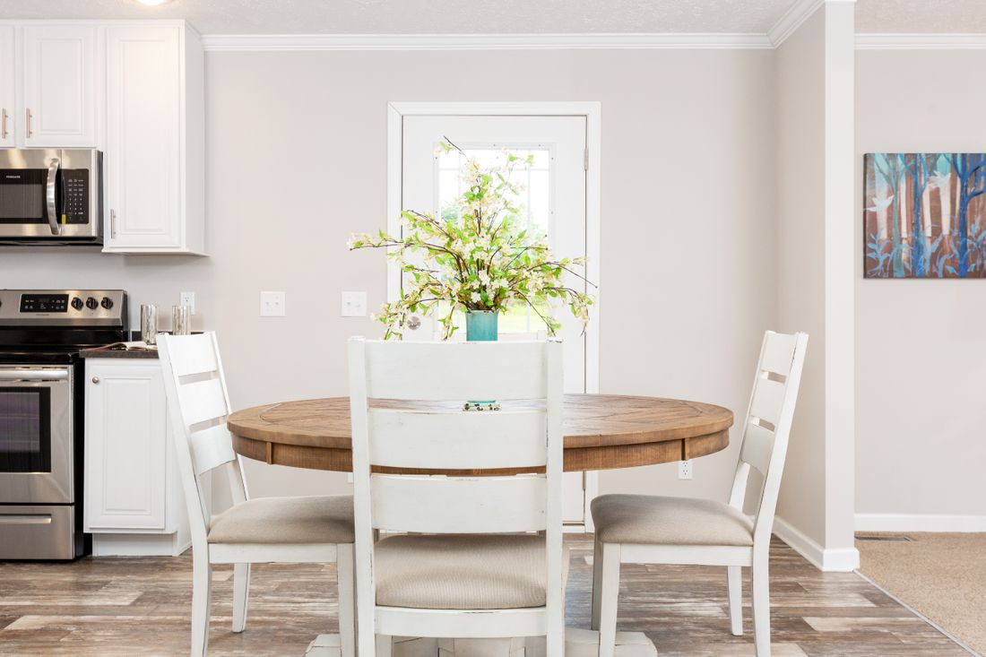 The SANTA FE 684A Dining Area. This Manufactured Mobile Home features 4 bedrooms and 2 baths.
