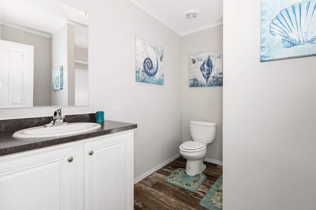 The SANTA FE 684A Guest Bathroom. This Manufactured Mobile Home features 4 bedrooms and 2 baths.