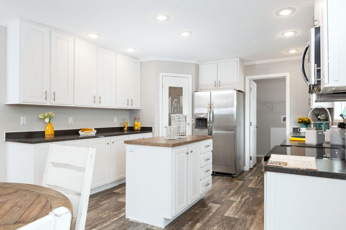 The SANTA FE 684A Kitchen. This Manufactured Mobile Home features 4 bedrooms and 2 baths.