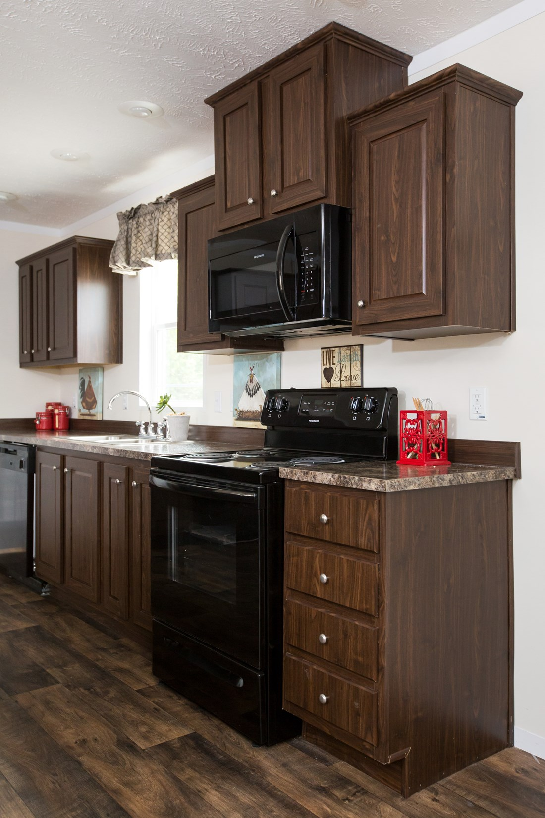 The RANGER 56B Kitchen. This Manufactured Mobile Home features 3 bedrooms and 2 baths.