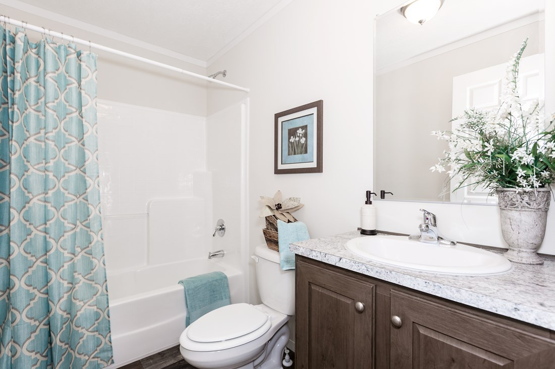 The CLASSIC 56G Guest Bathroom. This Manufactured Mobile Home features 3 bedrooms and 2 baths.