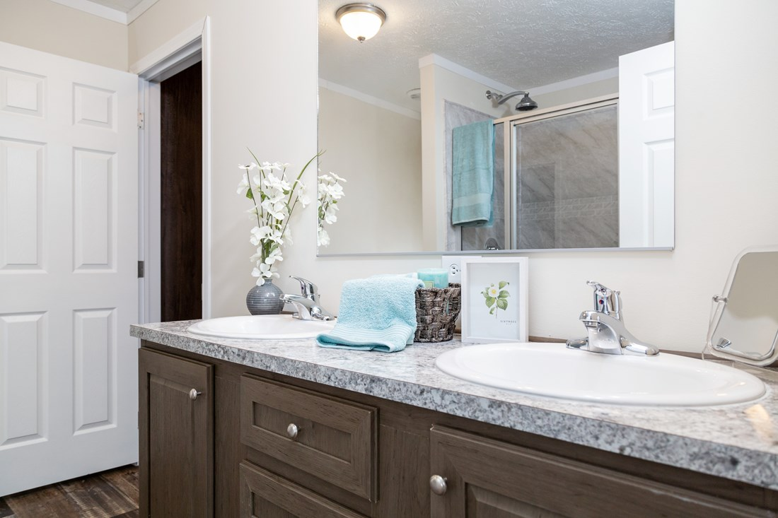 The CLASSIC 56G Master Bathroom. This Manufactured Mobile Home features 3 bedrooms and 2 baths.
