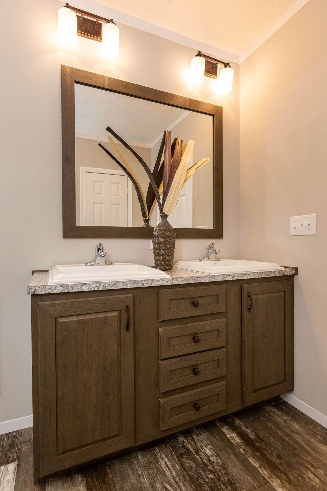 The CLASSIC 56D Master Bathroom. This Manufactured Mobile Home features 3 bedrooms and 2 baths.