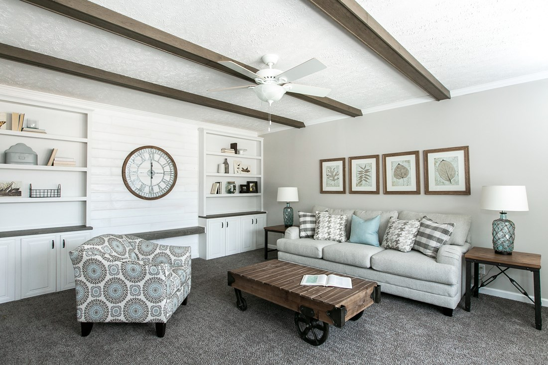 The COUNTRY AIRE Living Room. This Manufactured Mobile Home features 3 bedrooms and 3 baths.