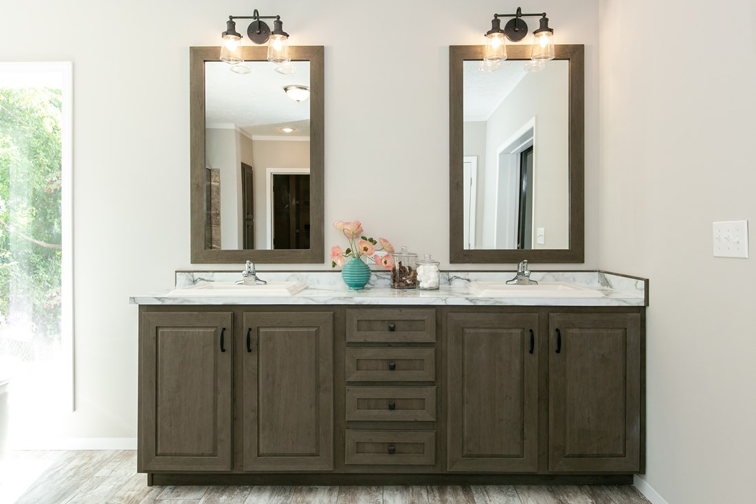 The COUNTRY AIRE Master Bathroom. This Manufactured Mobile Home features 3 bedrooms and 3 baths.
