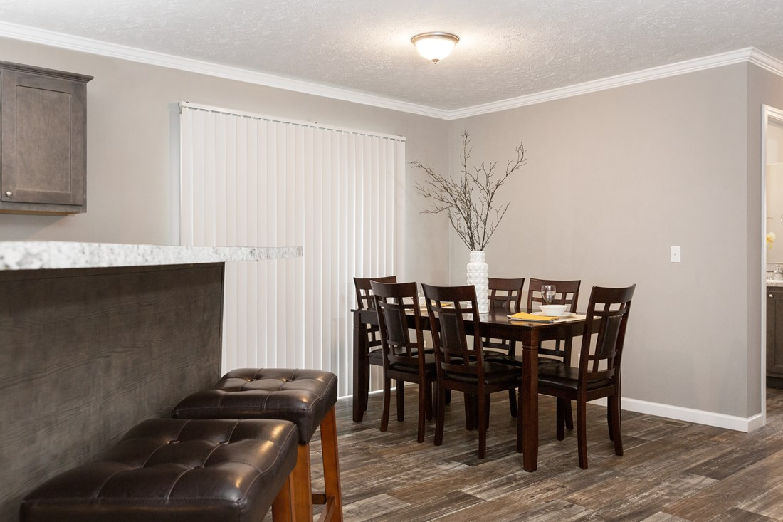 The TUCSON Dining Area. This Manufactured Mobile Home features 3 bedrooms and 2 baths.