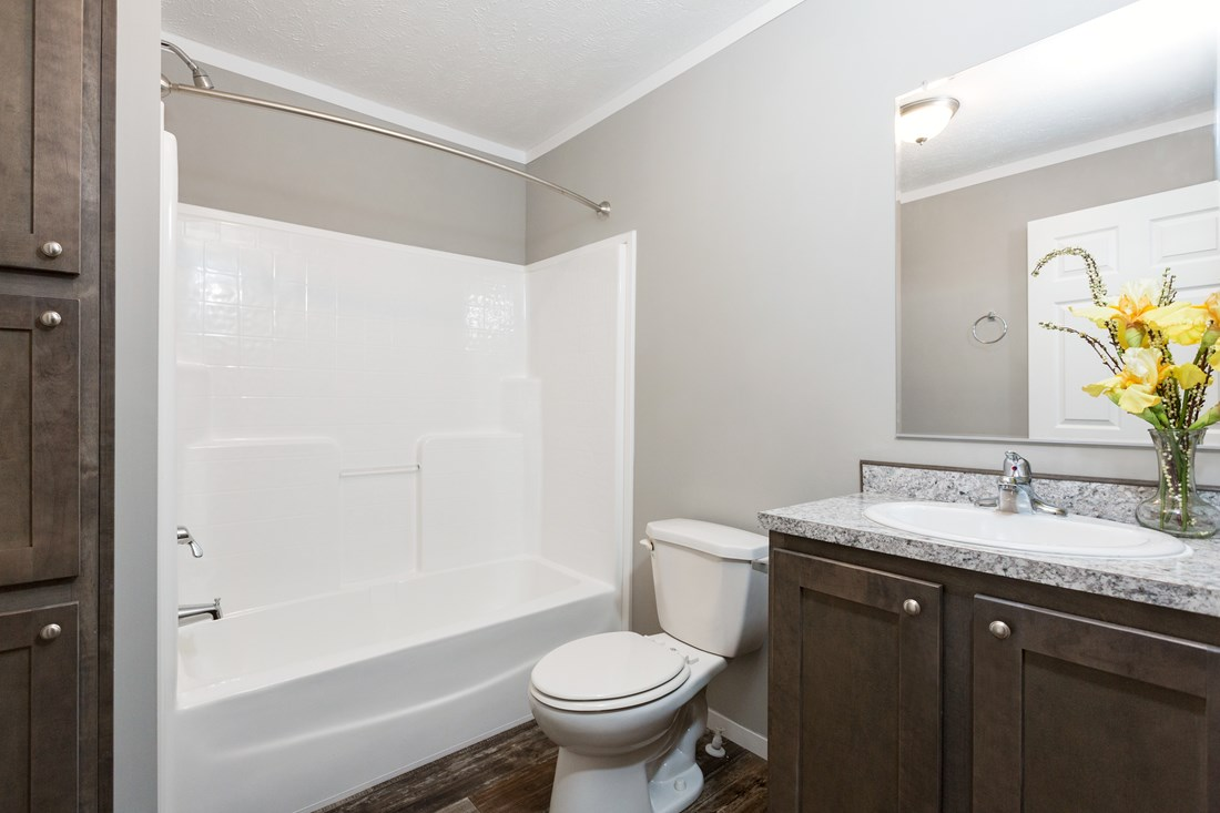 The TUCSON Guest Bathroom. This Manufactured Mobile Home features 3 bedrooms and 2 baths.