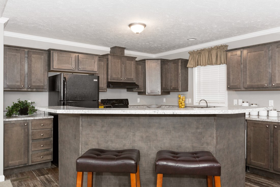 The TUCSON Kitchen. This Manufactured Mobile Home features 3 bedrooms and 2 baths.