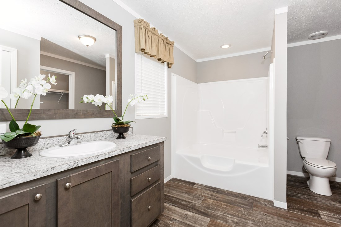 The TUCSON Master Bathroom. This Manufactured Mobile Home features 3 bedrooms and 2 baths.